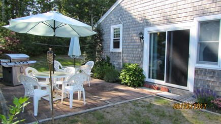 Dennisport Cape Cod vacation rental - Side entrance - Patio with gas grill