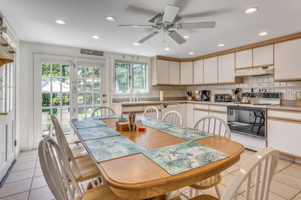 South Yarmouth Cape Cod vacation rental - Large, eat-in kitchen w/French doors to back patio and yard