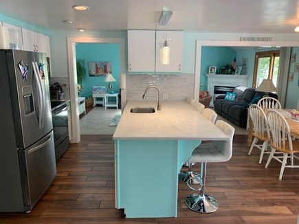 Mashpee, Popponesett Beach Cape Cod vacation rental - Kitchen with Island seating for 4 & table for 6.