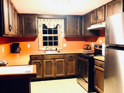 Eastham Cape Cod vacation rental - Kitchen, well supplied,opens to eat-in area and great room.