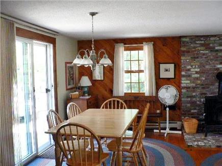 Eastham Cape Cod vacation rental - Dining area with sliders to walk-out deck and outdoor living.