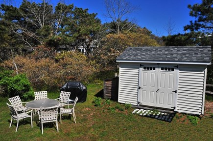 South Wellfleet Cape Cod vacation rental - Patio seating for up to six.  Patio under table not shown here.