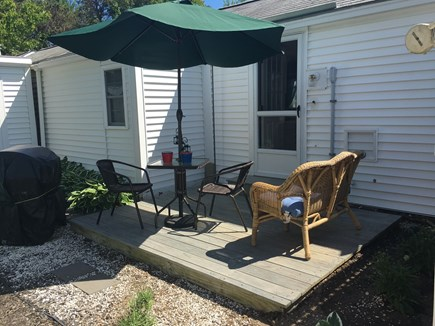 Dennis Port Cape Cod vacation rental - Backyard, includes gas grill, patio table with umbrella