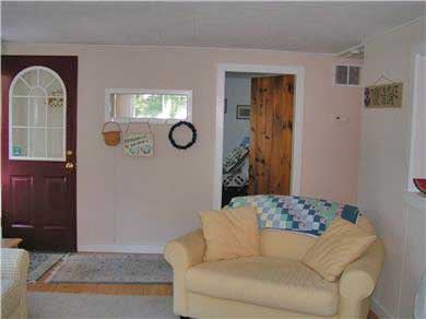 East Falmouth Cape Cod vacation rental - Living room with opening to kitchen on right