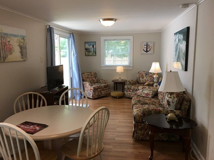 East Falmouth Cape Cod vacation rental - Dining Room & Den with sliders to the deck