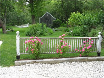 Brewster Cape Cod vacation rental - Approach to ''Garrett'' with potting shed in background