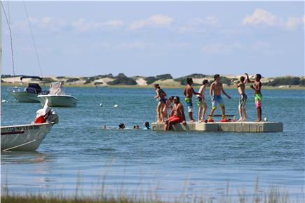 Barnstable Cape Cod vacation rental - Kids on the raft, just off the beach