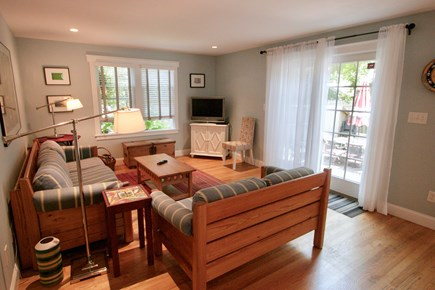 Dennis, North Side Cape Cod vacation rental - Living room area with sliding door to patio
