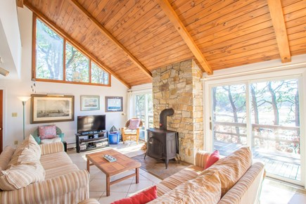 South Wellfleet Cape Cod vacation rental - Living room with amazing views, wood stove and flat screen TV.