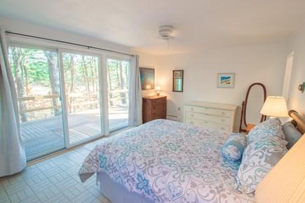 South Wellfleet Cape Cod vacation rental - 1st floor Master Bedroom with sliding glass doors & marsh views.