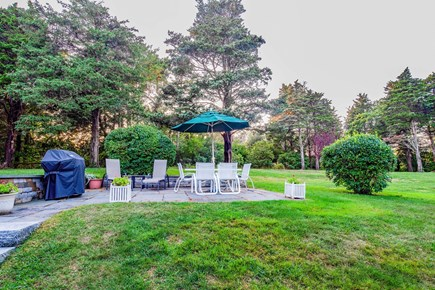 East Orleans Cape Cod vacation rental - Patio with Weber gas grill overlooking large yard