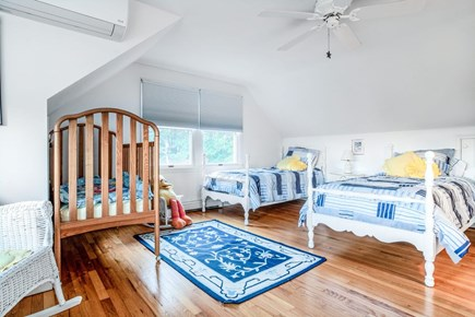 East Orleans Cape Cod vacation rental - Bedroom #2 on 2nd floor. Two twin beds and a crib. Central air.