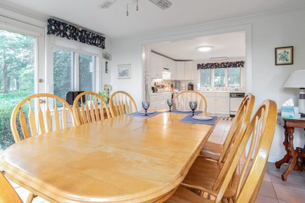 East Orleans Cape Cod vacation rental - Dining area with walls of windows opens to kitchen. Central air.