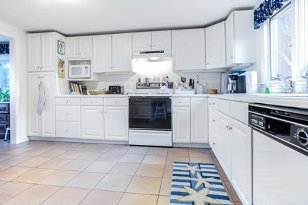 East Orleans Cape Cod vacation rental - Kitchen with dishes, lobster pot,lots of space & overlooks patio.