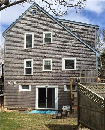 HarwichPort Cape Cod vacation rental - West Side: note shower on right &  slider to large side yard