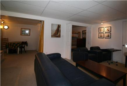 HarwichPort - 200 yds to beach Cape Cod vacation rental - Basement from TV area looking to the craft area and bunk room