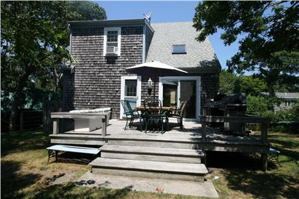 HarwichPort Cape Cod vacation rental - South facing private rear deck: 2 BBQs, speakers, and table for 8