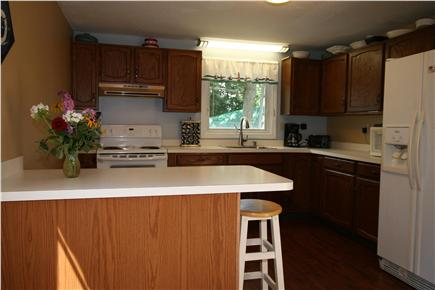 HarwichPort Cape Cod vacation rental - Kitchen w/ breakfast bar - new fridge, stove, dishwasher + + +