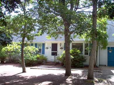 Harwich Port Cape Cod vacation rental - Front of House.  Trees keep the house cool. Large driveway