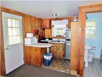 Truro Cape Cod vacation rental - Kitchen and bathroom (laundry machines just out of view)