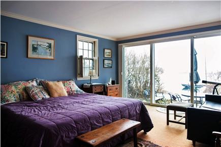 Harwich Port Cape Cod vacation rental - Master bedroom with view out to terrace with table and chairs