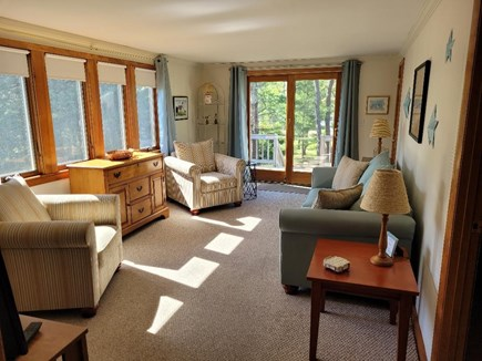 Dennis Port Cape Cod vacation rental - Bright living room with slider to deck