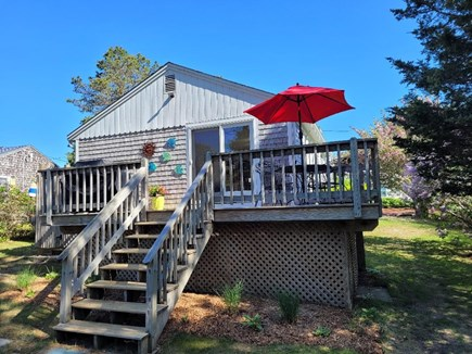 Dennis Port Cape Cod vacation rental - Back deck with seating and Weber gas grill