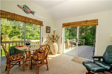 East Orleans Cape Cod vacation rental - The airy sunroom.  Nature's relaxing retreat.  Full carpeting.