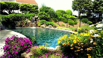 East Orleans Cape Cod vacation rental - Pool waterfall with 180 degre underwater seating below.