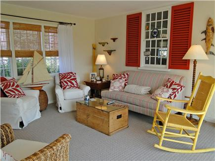 West Harwich Cape Cod vacation rental - Comfortable family room with TV, slider to patio