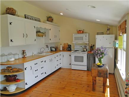 West Harwich Cape Cod vacation rental - Kitchen area with second dining area, faces lawn