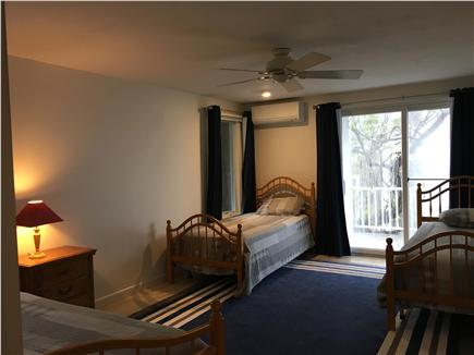 Dennis Cape Cod vacation rental - Bedroom - new hardwood, with sliders to deck.