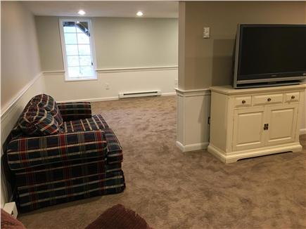 Dennis Cape Cod vacation rental - Full finished walkout basement with TV and half bath.