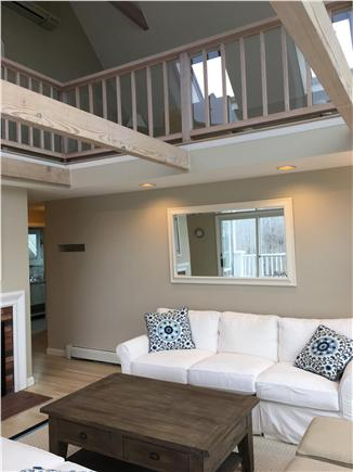 Dennis Cape Cod vacation rental - Living room with gas fireplace, and loft above