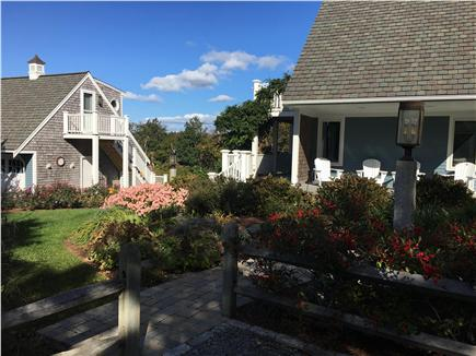 Dennis Cape Cod vacation rental - Front Yard (October). Garage left, house right. New landscaping.