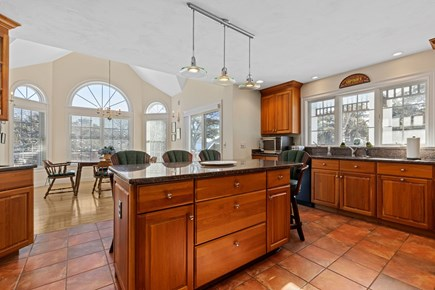 Chatham, downtown Cape Cod vacation rental - Spacious kitchen with large island and bar stools