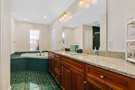 Chatham, downtown Cape Cod vacation rental - Master bath with two sinks, a 2 person jacuzzi and and a shower