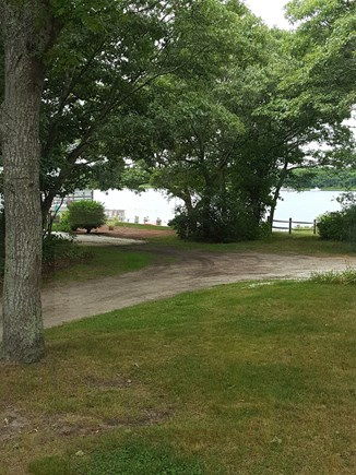 Mashpee, Monomoscoy - steps to water Cape Cod vacation rental - Side yard - Facing Water