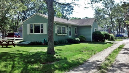 Mashpee, Monomoscoy - steps to water Cape Cod vacation rental - Cottage is located in a pretty setting on a quiet road