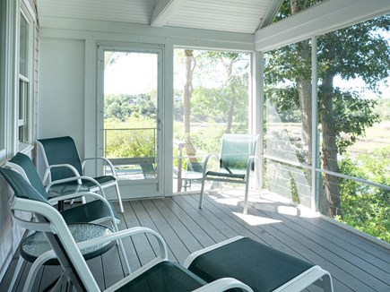 Truro Cape Cod vacation rental - Screen porch with chairs