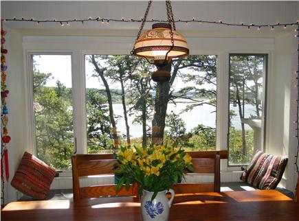 S. Wellfleet Cape Cod vacation rental - Dining table and window seat, facing water