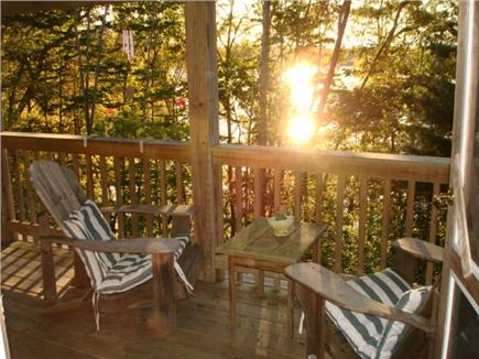 Brewster Cape Cod vacation rental - Deck chairs facing pond and soothing sunrise.