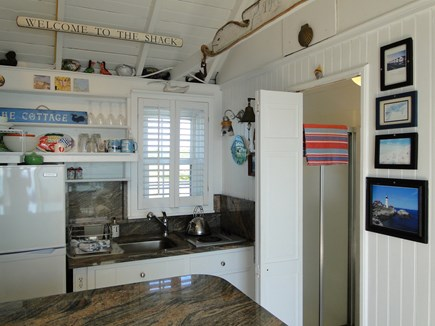 North Truro Cape Cod vacation rental - Kitchen area with full size refrigerator and breakfast bar