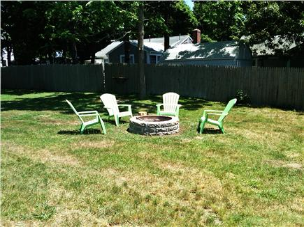 West Yarmouth Cape Cod vacation rental - Relax next to the outdoor fireplace. Huge triple lot for games!