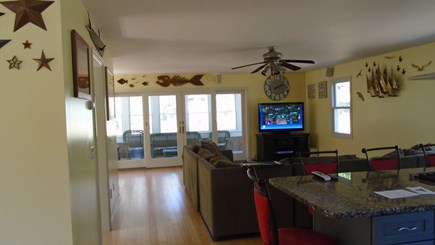 North Truro Cape Cod vacation rental - Living room screen porch at end