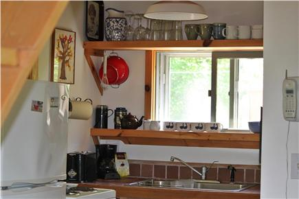 Wellfleet  Cape Cod vacation rental - Kitchen area includes range with oven, refrigerator & microwave