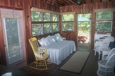 North Eastham Cape Cod vacation rental - Porch (dining area not shown), opens to side yard and patio.