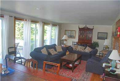 Barnstable Cape Cod vacation rental - Comfortable living room with dining table, fireplace & sliders