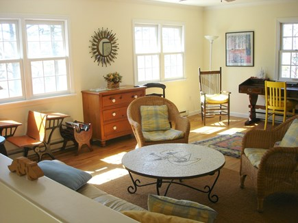 East Orleans Cape Cod vacation rental - Sunlit living room with large overhead fan and cross ventilation