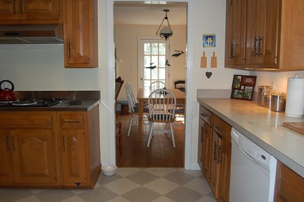 East Orleans Cape Cod vacation rental - Kitchen conveniently opens to dining and french doors to deck